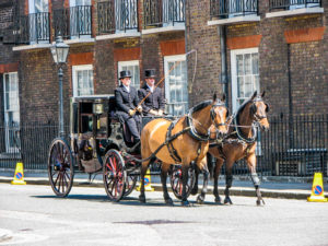 A Royal horse and carriage passing St James Palace - London: 60 Things to See & Do - The Trusted Traveller