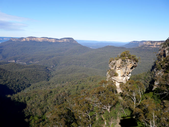 On the Skyway looking over the Jamison Valley and Orphan Rock - Visiting Scenic World in Australia's Blue Mountains