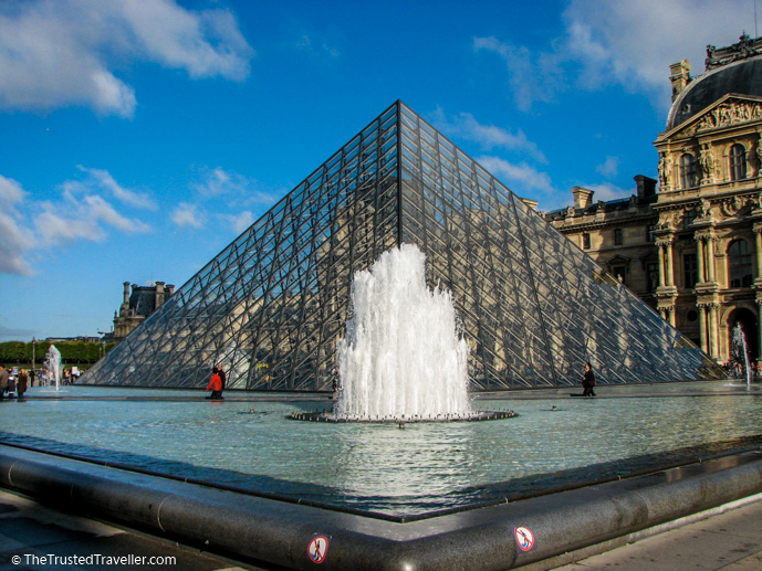 The glass pyramid at the Louvre - 30 Things to Do in Paris - The Trusted Traveller