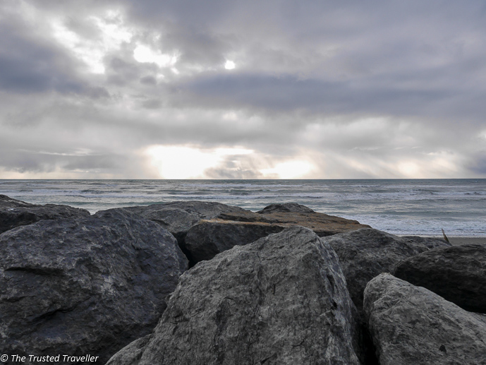 The beach at Punakaiki during sunseti - Driving New Zealand's Wild West Coast - Things to See & Do - The Trusted Traveller