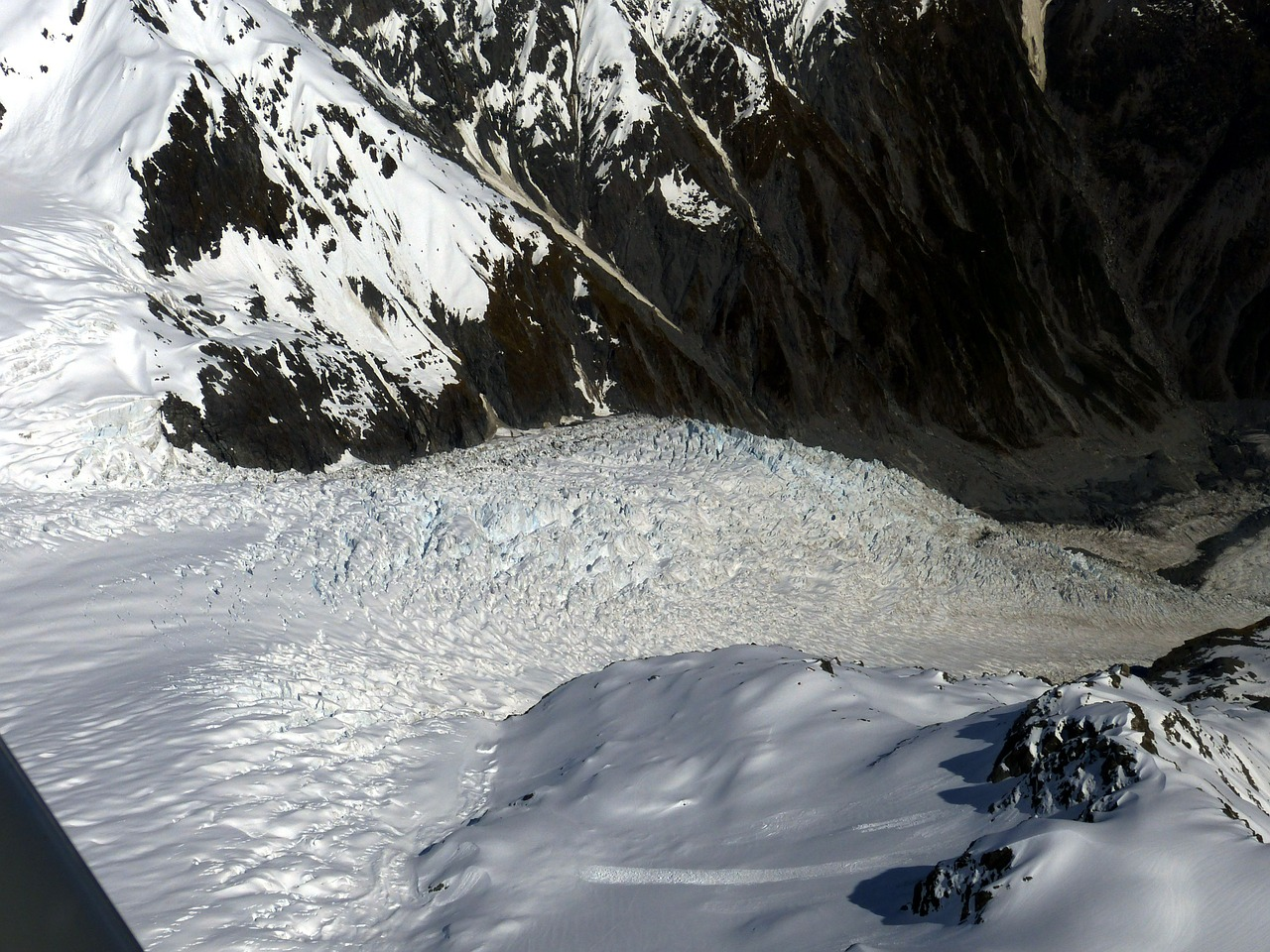 Looking down over the glacier from a helicopter - Things to Do in New Zealand's Glacier Country - The Trusted Traveller