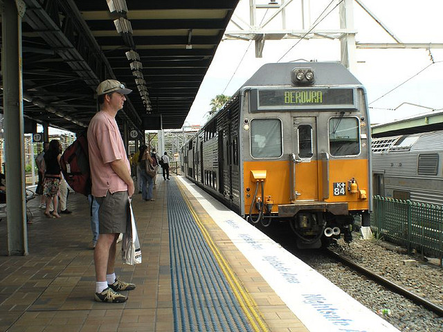 Stand behind the yellow line until the train stops - Image Credit