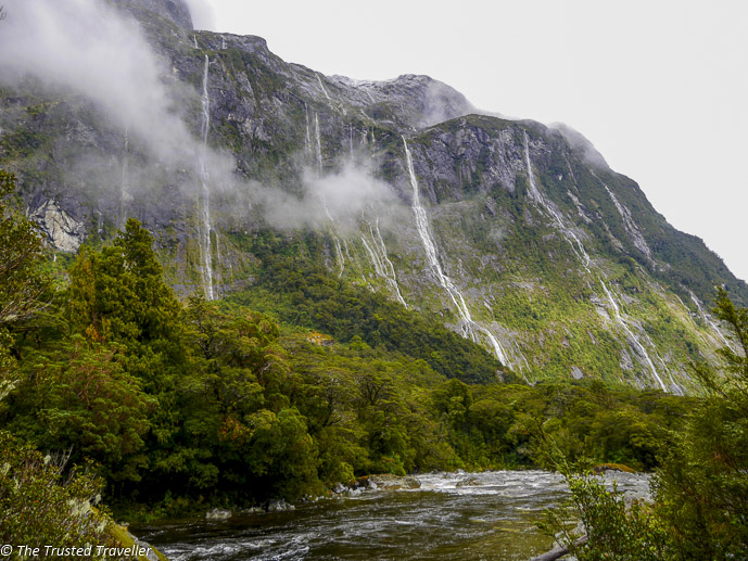 Waterfalls on the side of the road - Our Journey to Milford Sound - In Photos - The Trusted Traveller