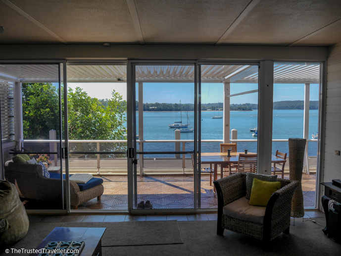 Looking out to the terrace and Clyde River from the living area - Bay Breeze Boutique Motel: Luxury on the Eurobodalla Coast - The Trusted Traveller