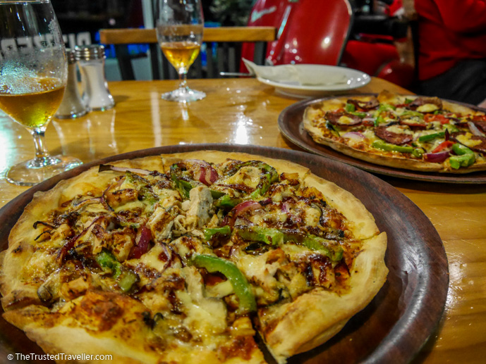 Our mains: BBQ Chicken Pizza and Em's Pizza - 7 Eurobodalla Culinary Delights That Should Not to Be Missed - The Trusted Traveller