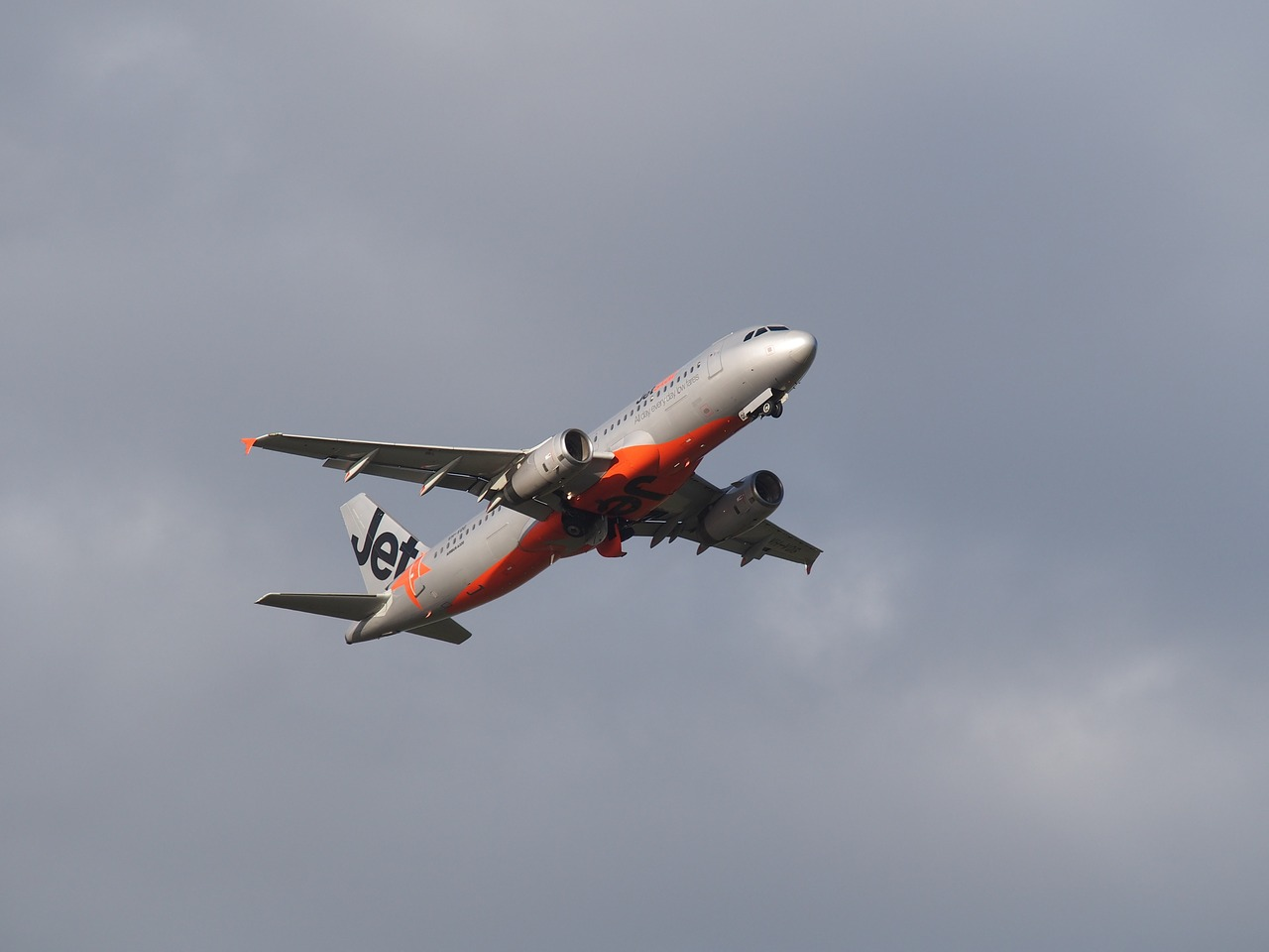 Jetstar flight taking off - The Complete Guide to Getting Around Australia - The Trusted Traveller