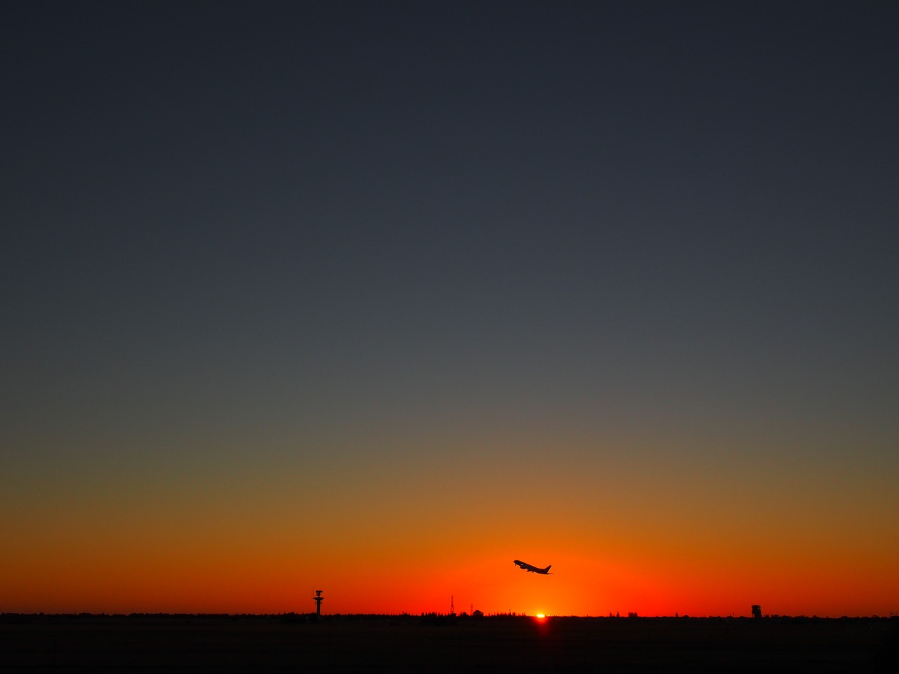A plane taking off at sunset in Adelaide - The Complete Guide to Getting Around Australia - The Trusted Traveller