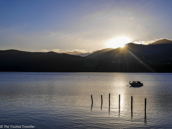 Lake Te Anau at sunset - Two Week New Zealand South Island Road Trip Itinerary - The Trusted Traveller