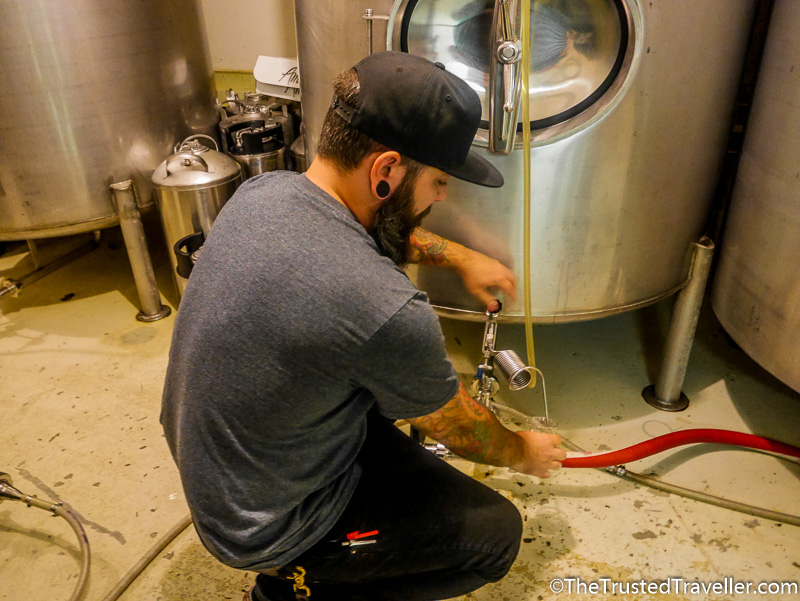 Tasting beer right from the tank at Swans Brewery - How to Visit the Best Craft Breweries in Victoria BC - The Trusted Traveller